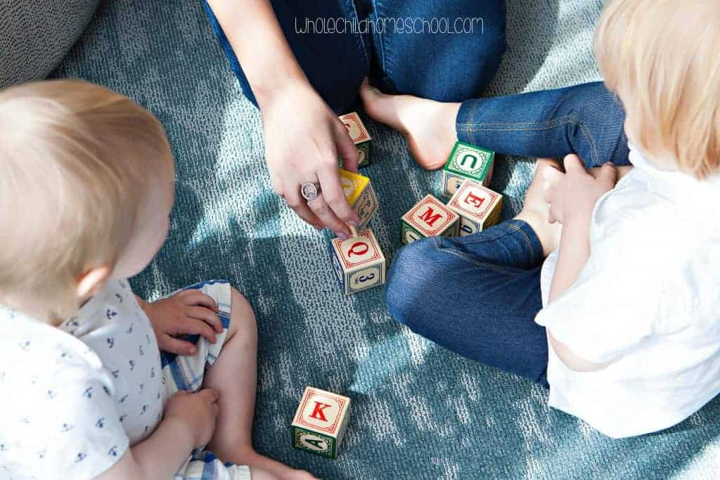 mom and daughters playing with blocks ten truths for beginning homeschoolers wholechildhomeschool.com